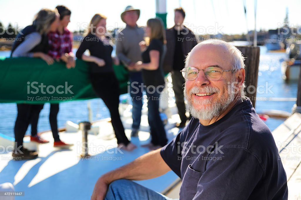 Grandfather and His Family on Sailboat stock photo