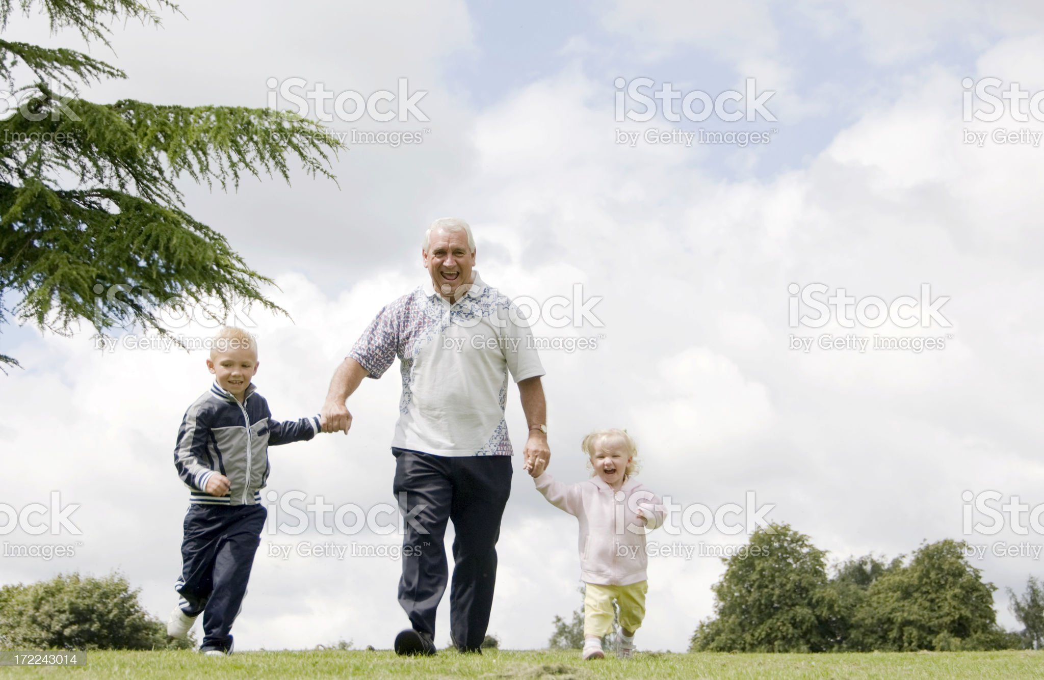 grandfather and his grandchildren royalty-free stock photo