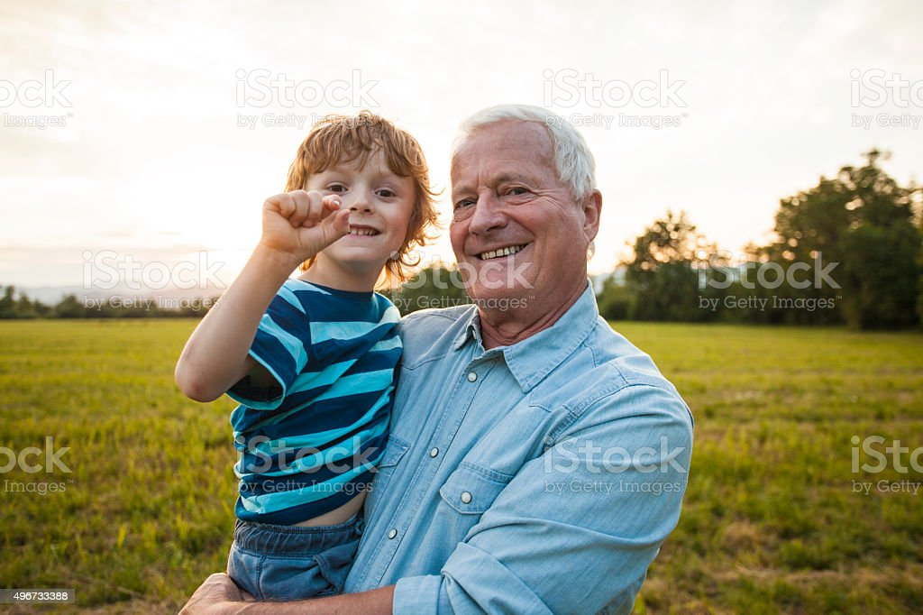 Grandfather and his grandson stock photo