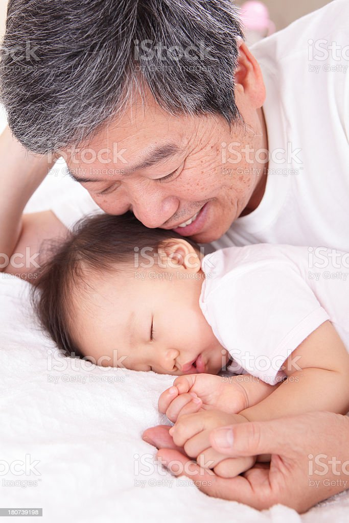 grandfather and his sleeping granddaughter royalty-free stock photo