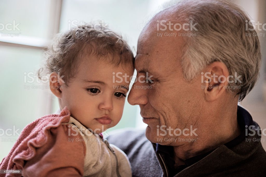 grandfather and little girl royalty-free stock photo