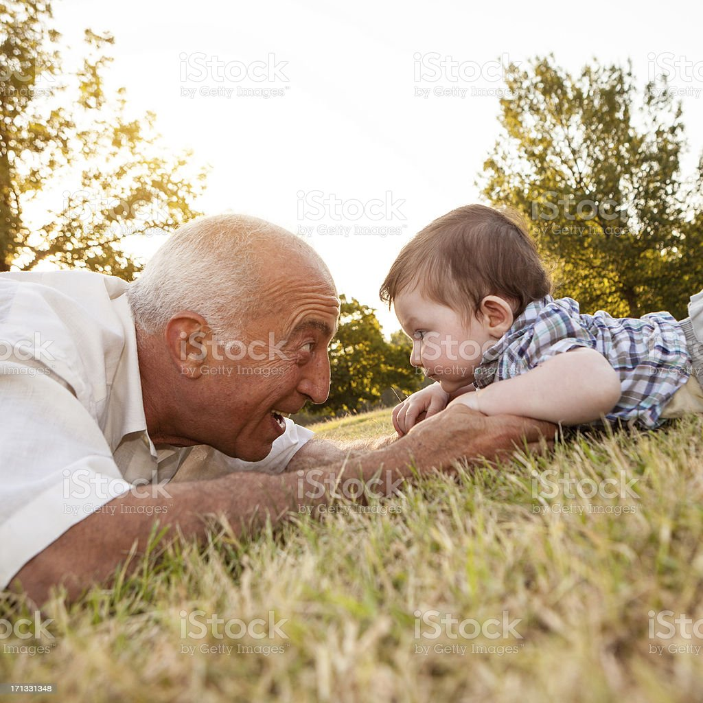 Grandfather and niece at park stock photo