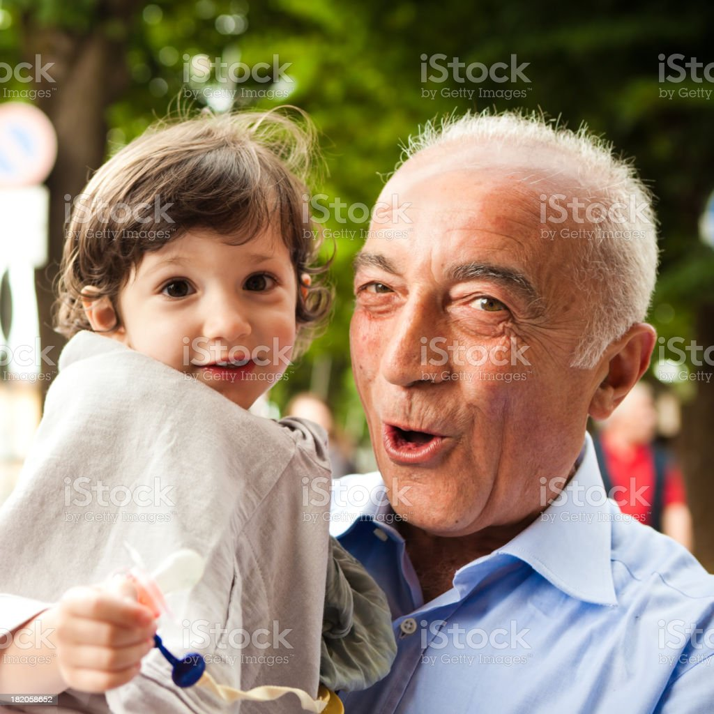 Grandfather and niece smiling at camera royalty-free stock photo