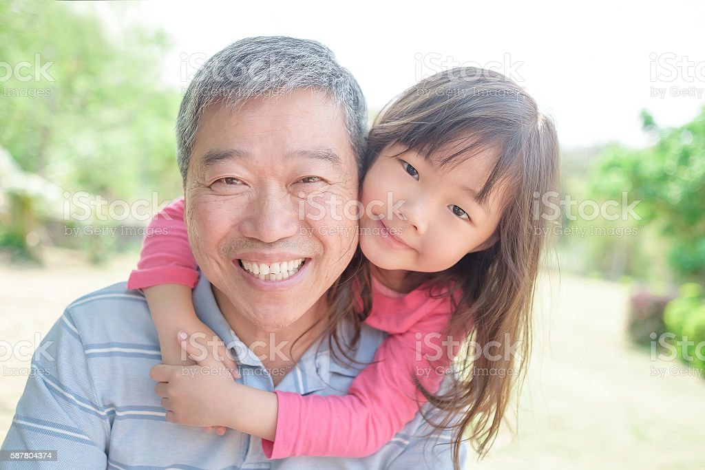grandfather carrying cute granddaughter selfi stock photo