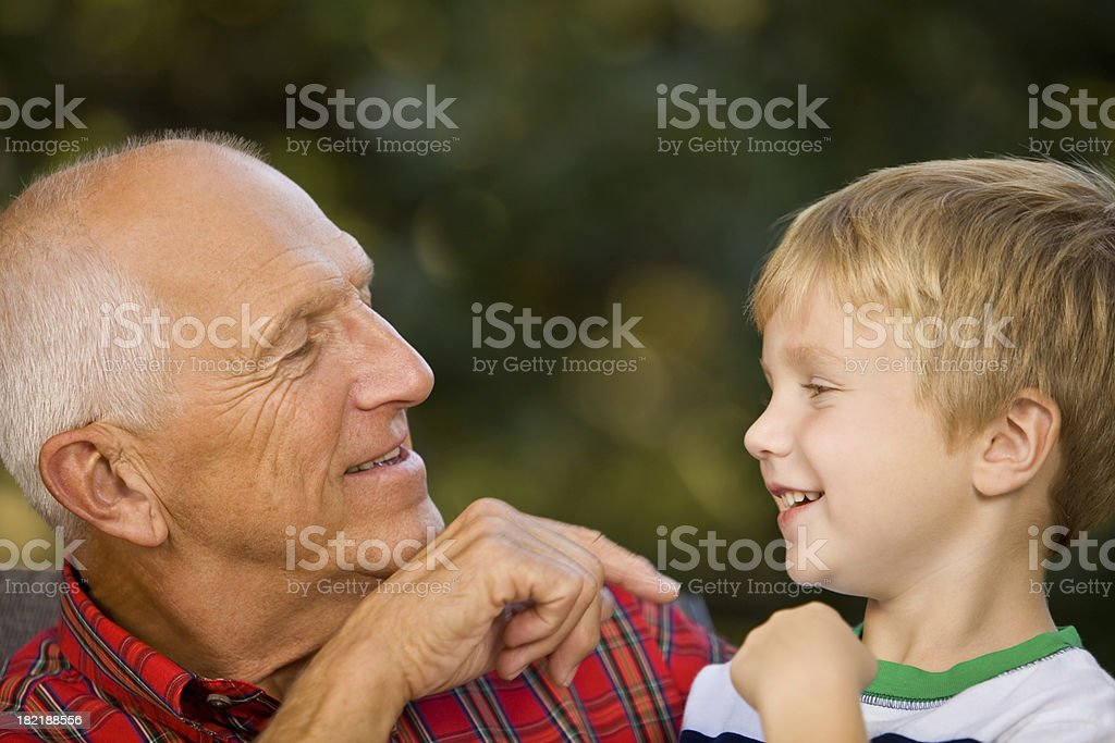 Grandfather Entertaining Grandson royalty-free stock photo
