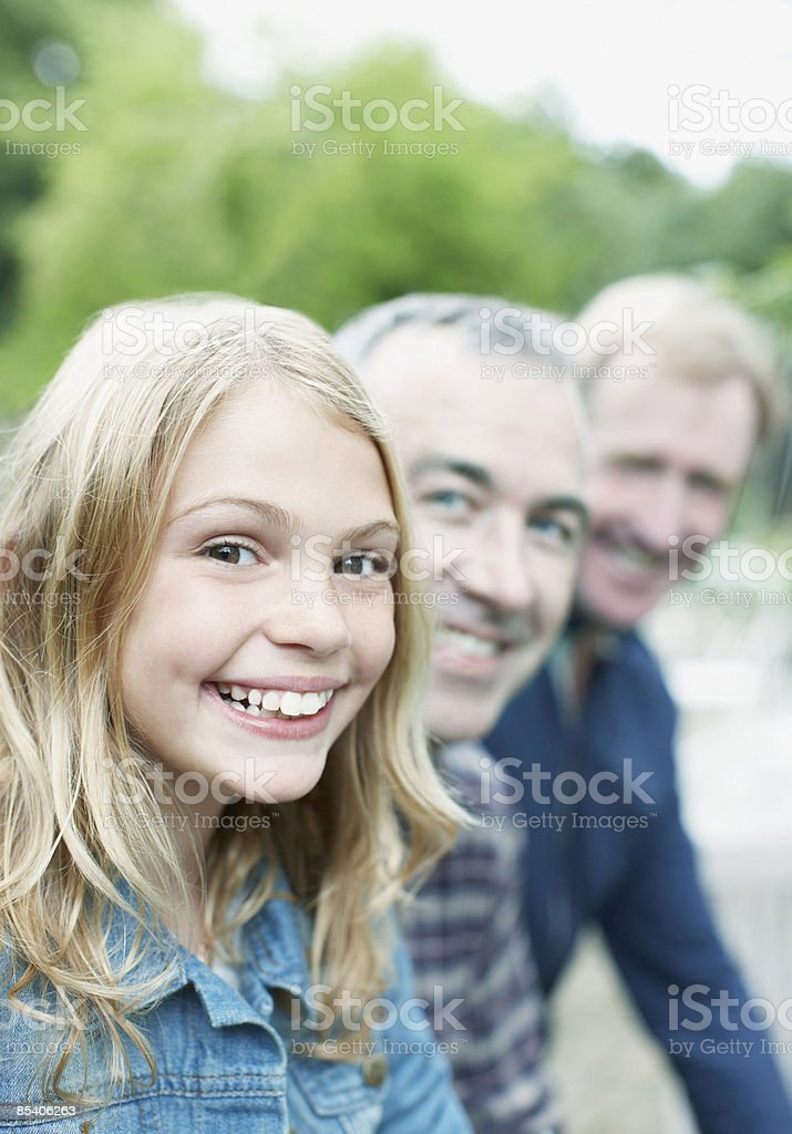 Grandfather, father and daughter smiling royalty-free stock photo