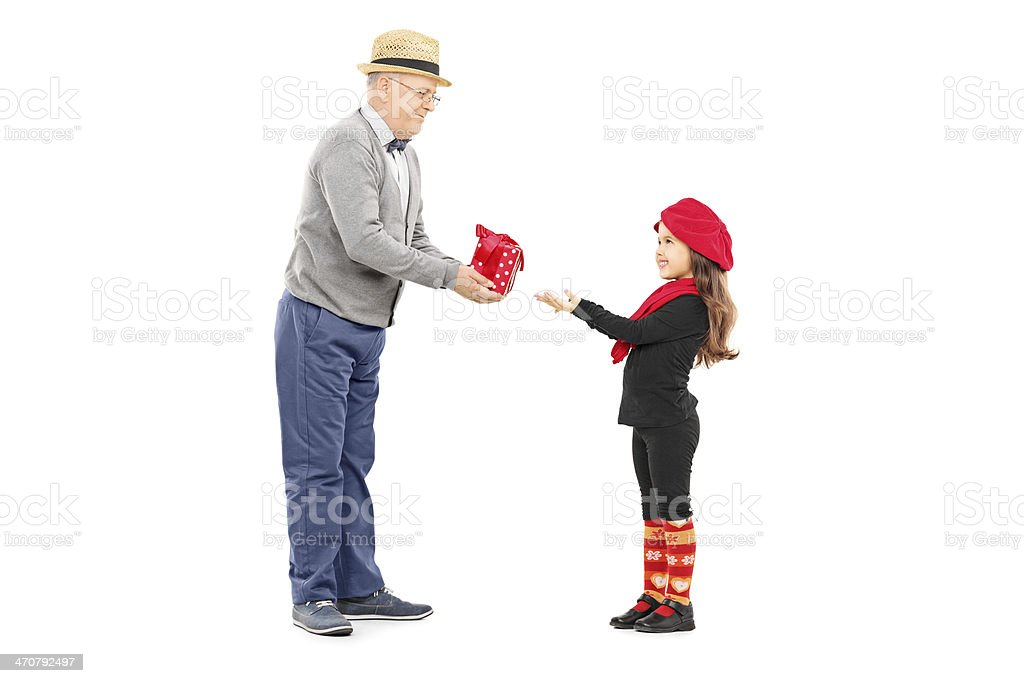 Grandfather giving present to his little niece stock photo