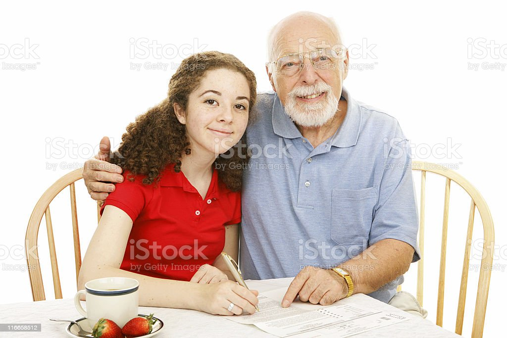 Grandfather Helping Teen royalty-free stock photo
