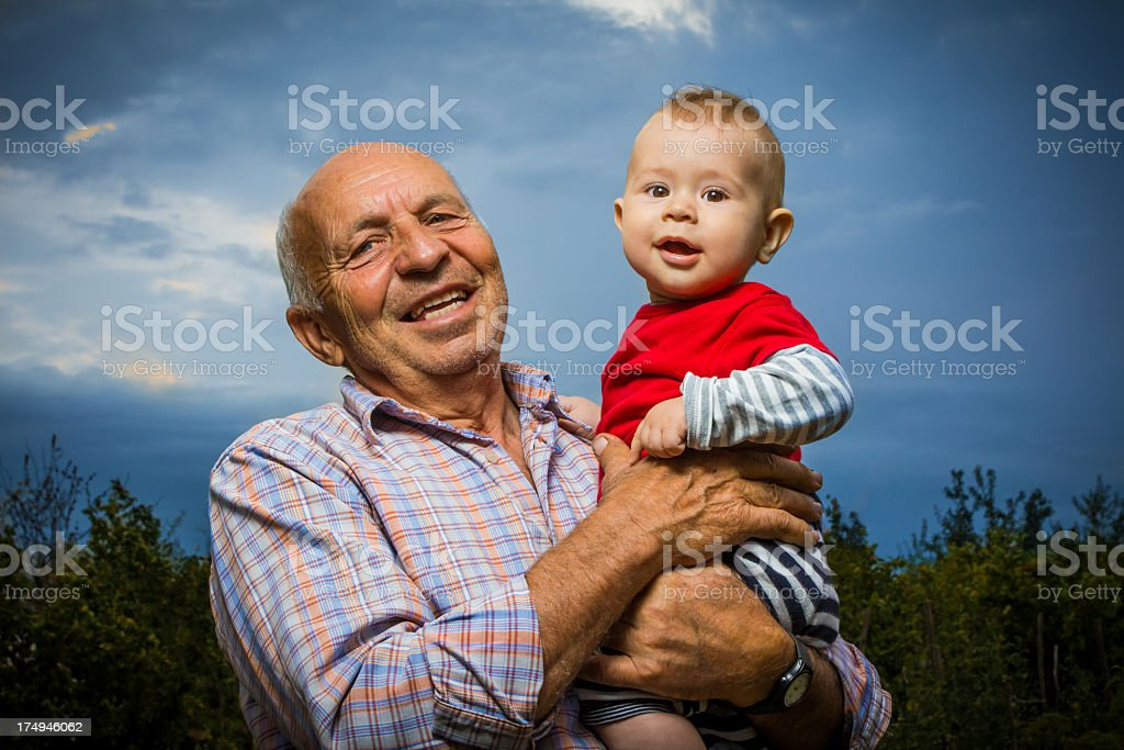 Grandfather Holding Grandson stock photo