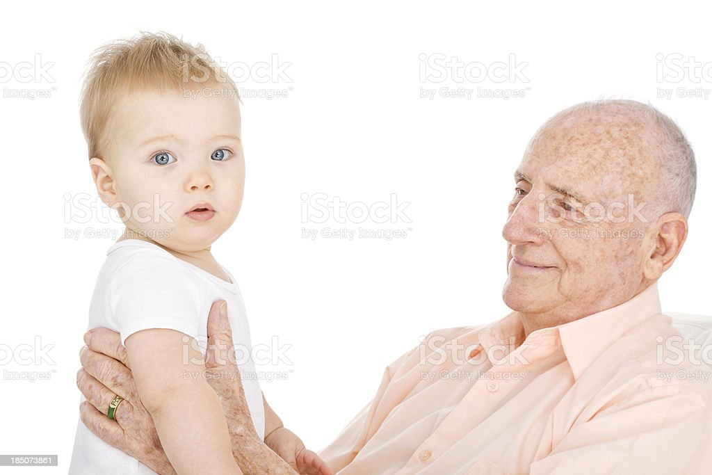 Grandfather Holding Up Baby Boy stock photo