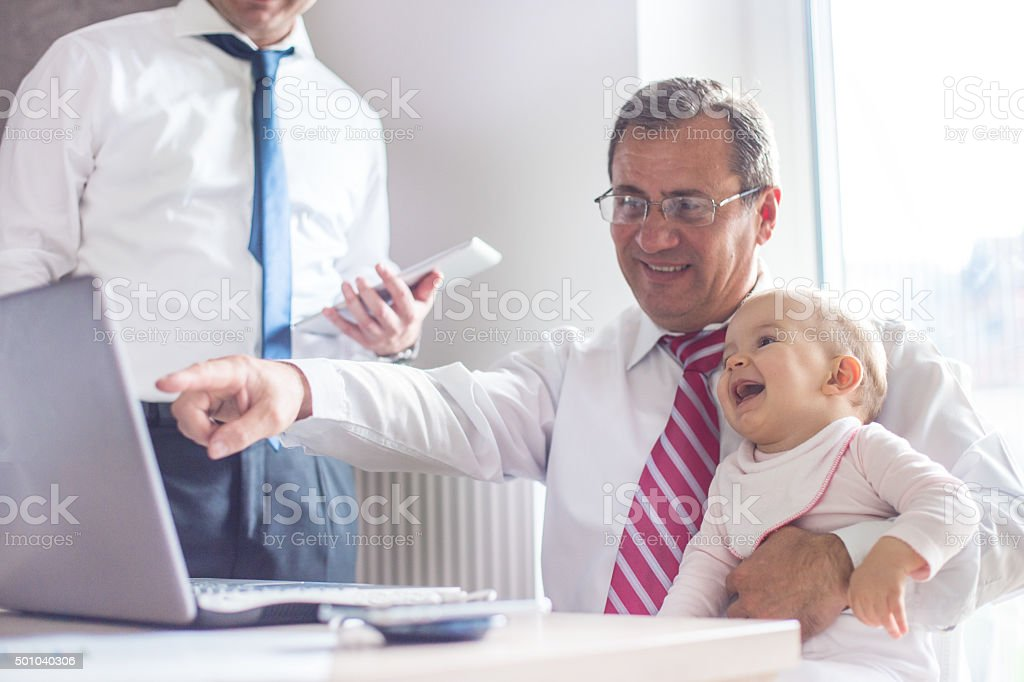 Grandfather holds granddaughter stock photo