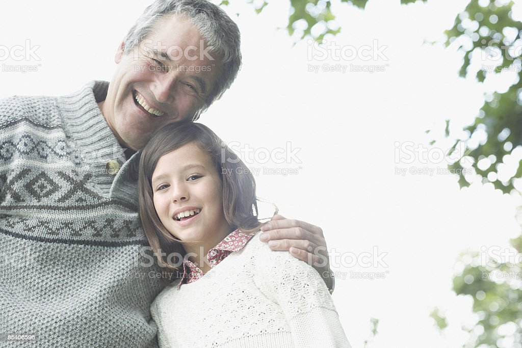 Grandfather hugging granddaughter royalty-free stock photo