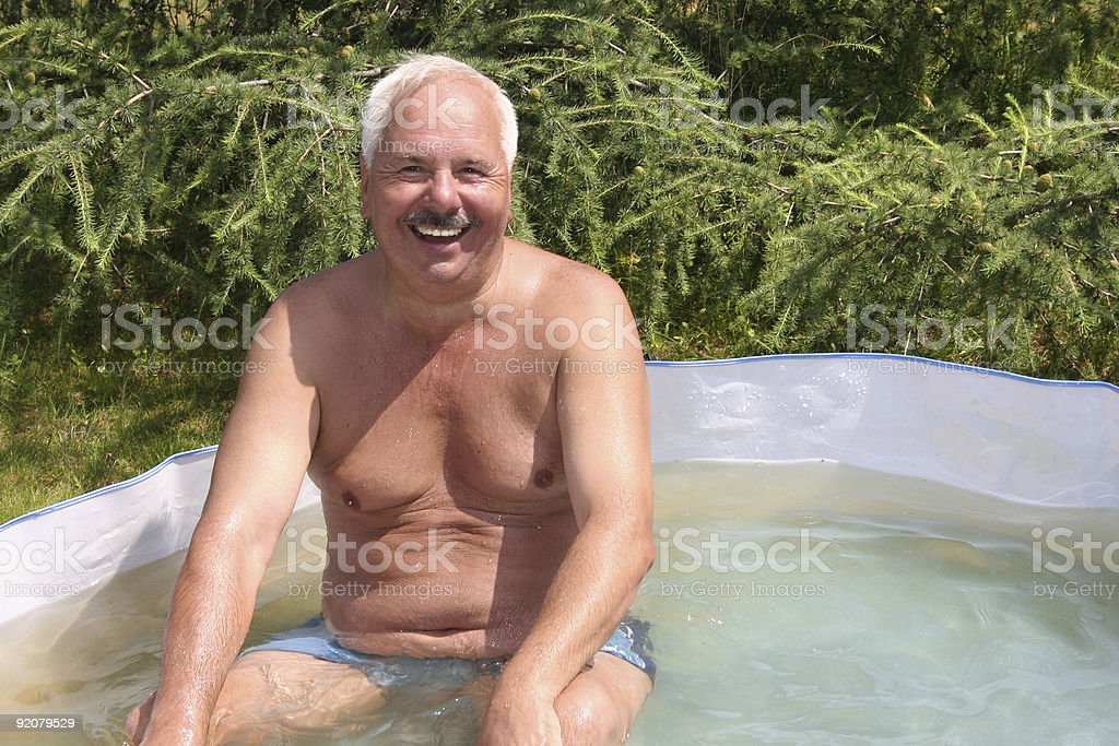Grandfather in small pool royalty-free stock photo