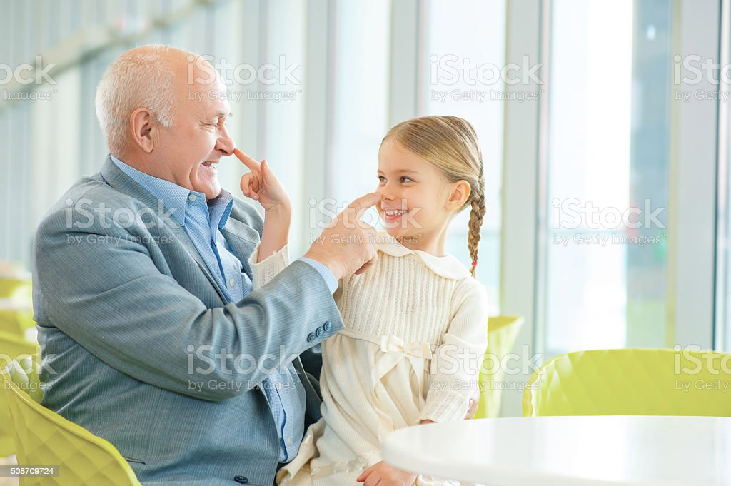 Grandfather meeting his cute granddaughter stock photo