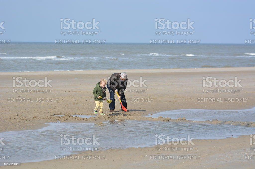 Grandfather on beach in Bergen ann Zee, Netherlands stock photo