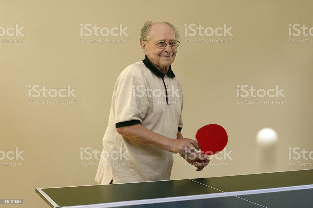 Grandfather playing ping pong royalty-free stock photo