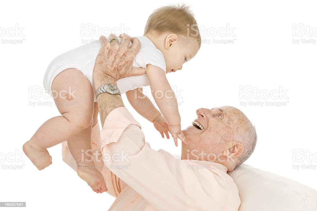Grandfather Playing with Baby stock photo
