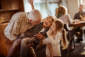 Grandfather playing with his grandkids