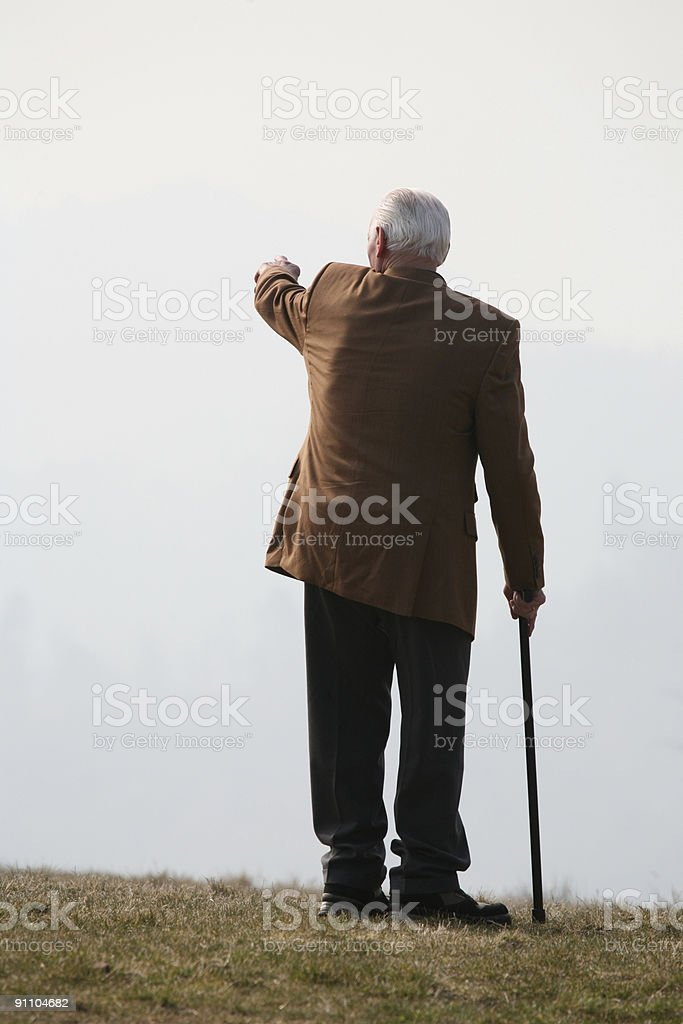 Grandfather pointing down the valley. royalty-free stock photo