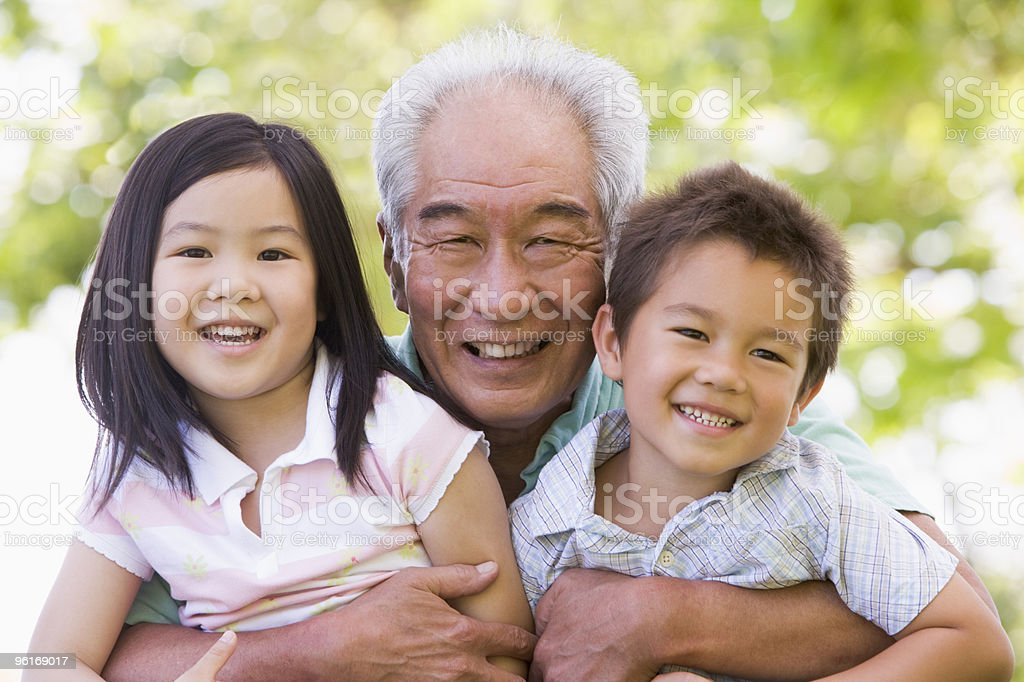 Grandfather posing with grandchildren royalty-free stock photo