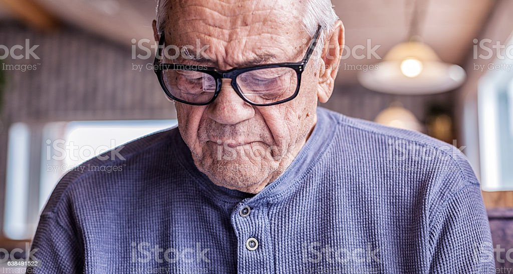 Grandfather Wearing Hearing Aid Reading Reflected Restaurant Menu stock photo