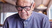 Grandfather Wearing Hearing Aid Reading Reflected Restaurant Menu