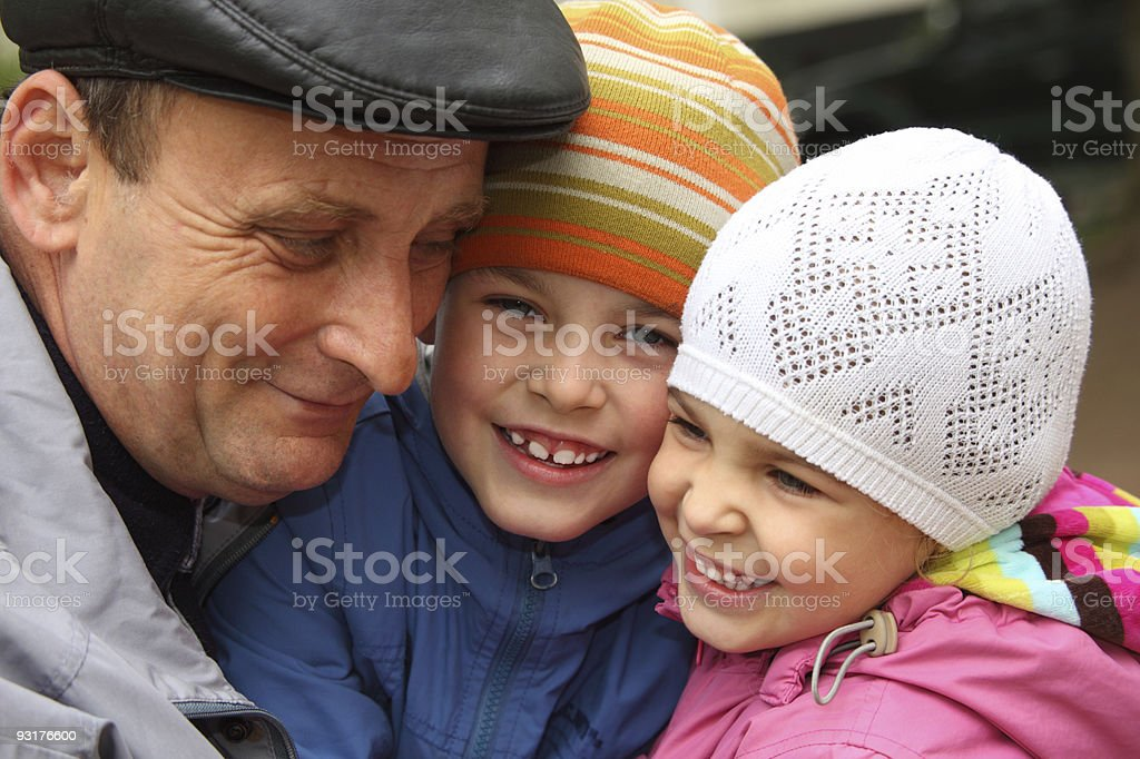 Grandfather with grandchildren outdoor royalty-free stock photo