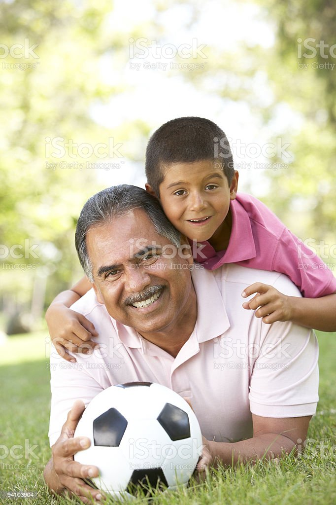 Grandfather With Grandson In Park royalty-free stock photo