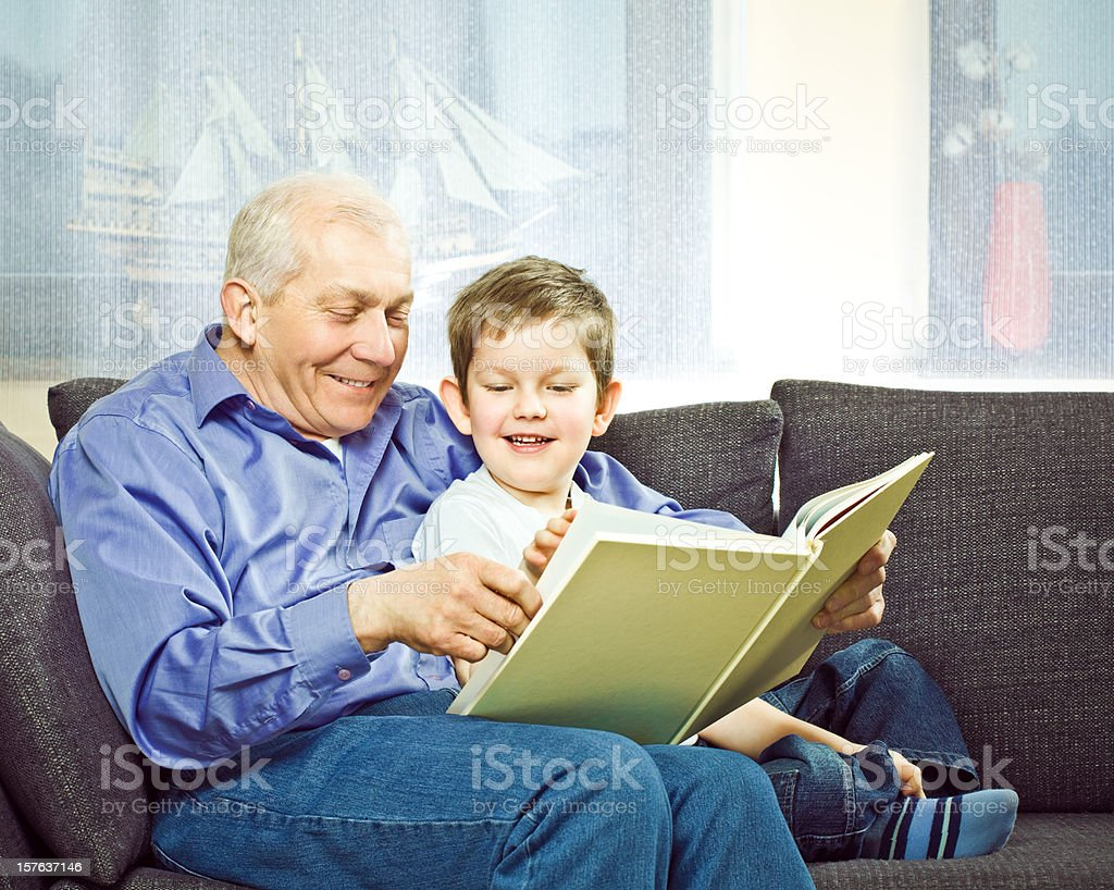 Grandfather with grandson reading book royalty-free stock photo
