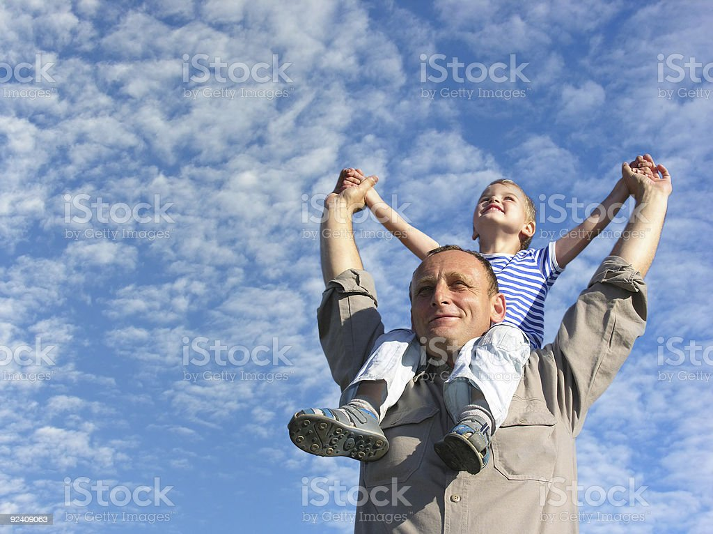 grandfather with grandson under cloudfield stock photo
