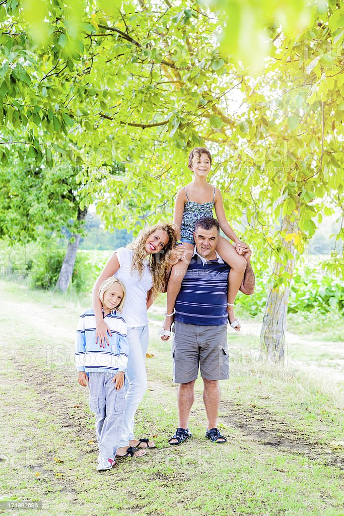 Grandfather with Grandsons, Family Portrait in Nature royalty-free stock photo