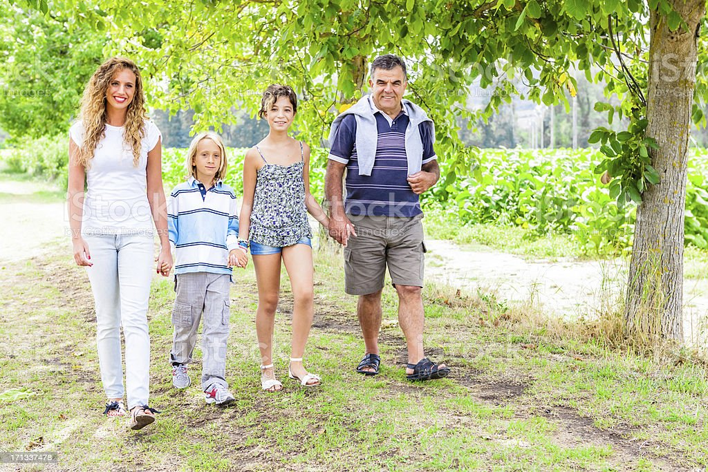 Grandfather with Grandsons Walking in Nature royalty-free stock photo