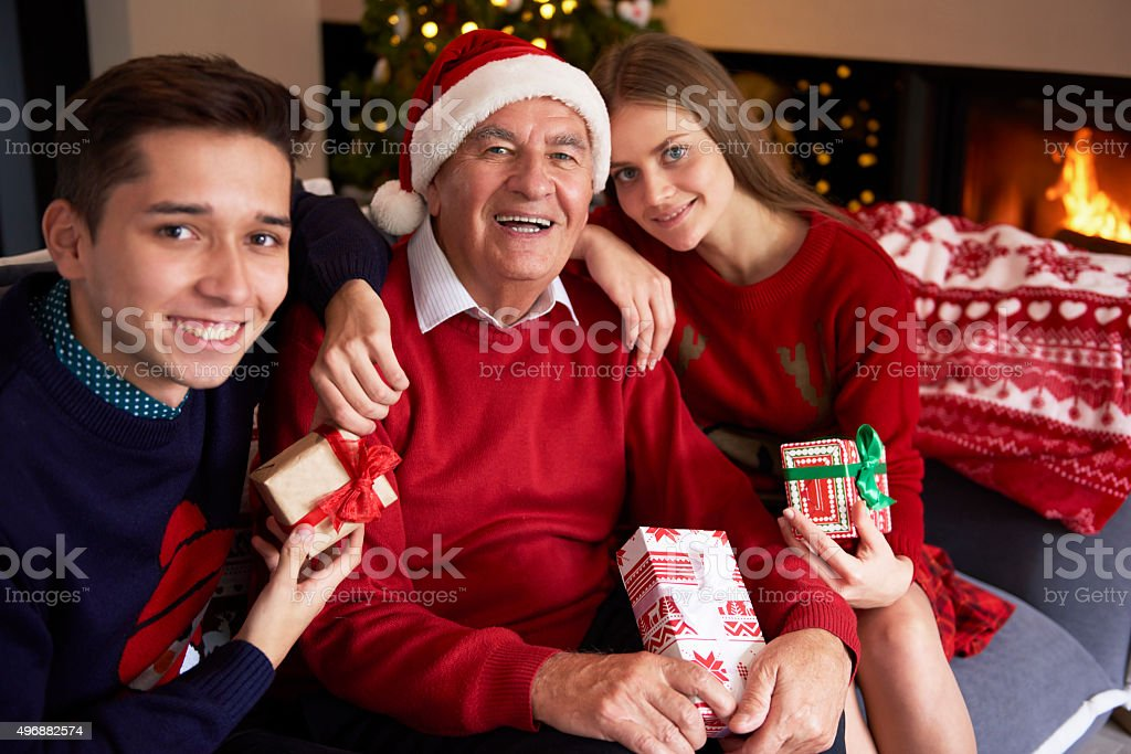 Grandfather with his beloved grandchildren stock photo