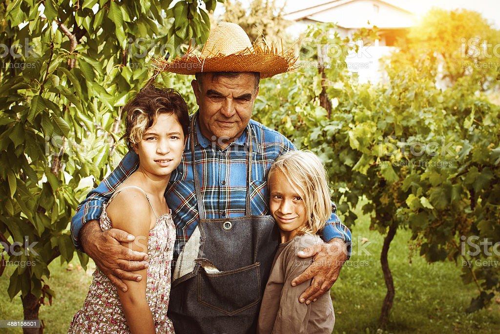 Grandfather with his grandchildren stock photo