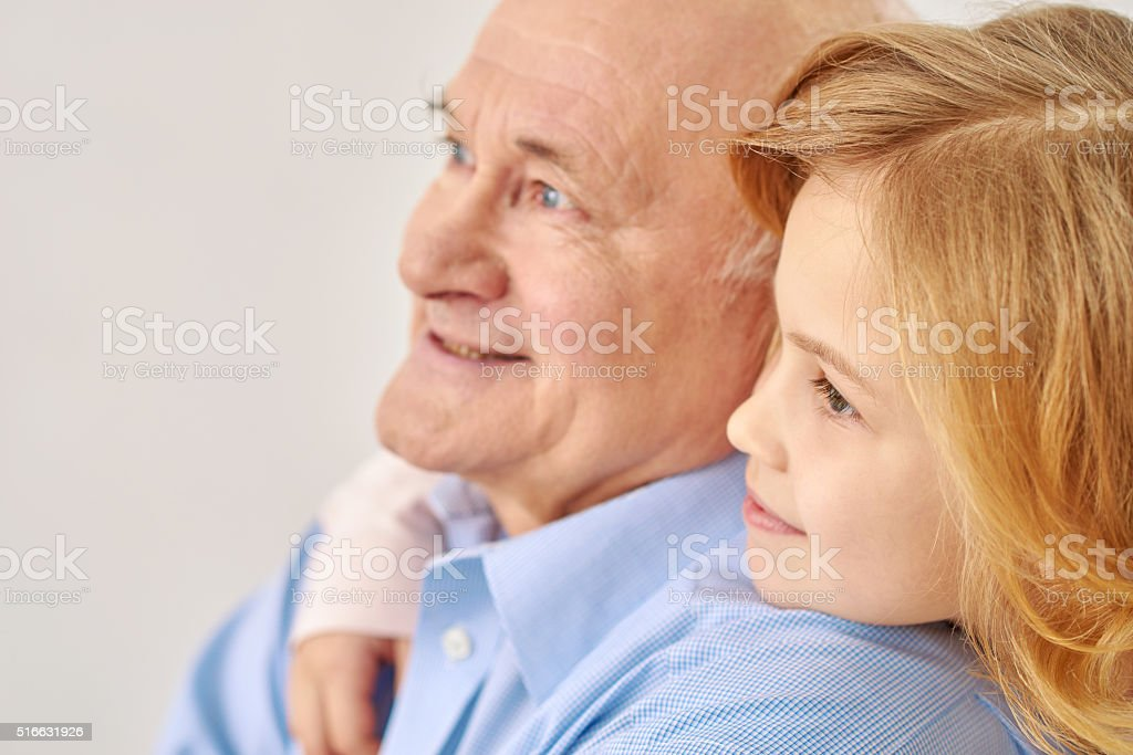 Grandfather with his granddaughter stock photo
