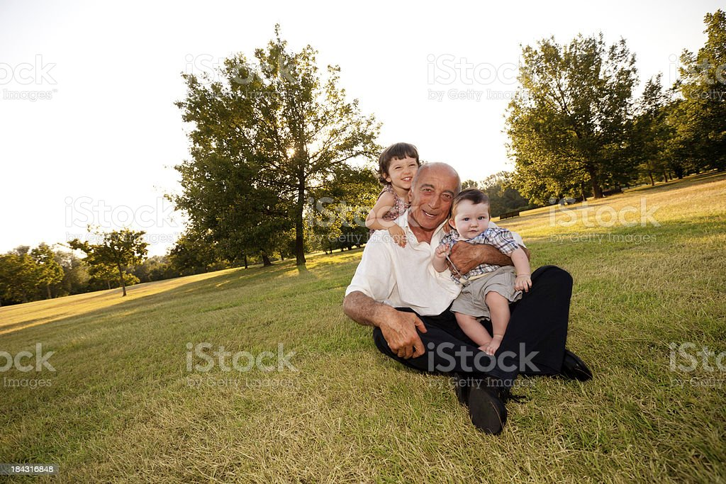 Grandfather with nephew and niece, smiling stock photo