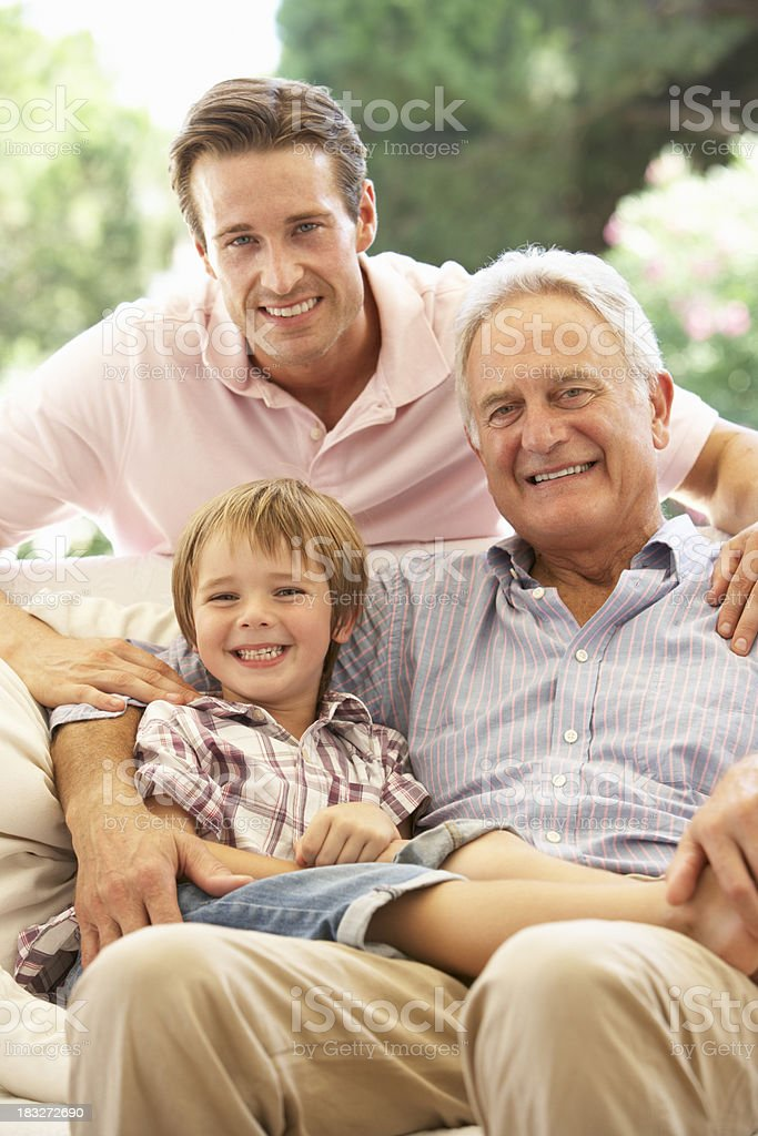 Grandfather With Son And Grandson Laughing On Sofa royalty-free stock photo