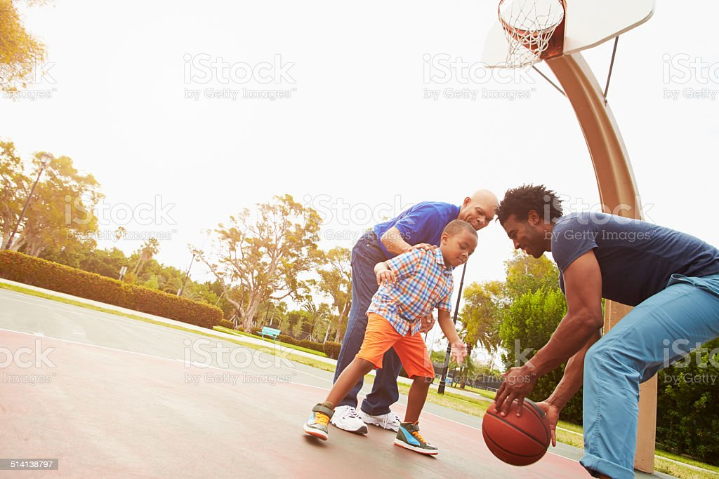 Grandfather With Son And Grandson Playing Basketball stock photo