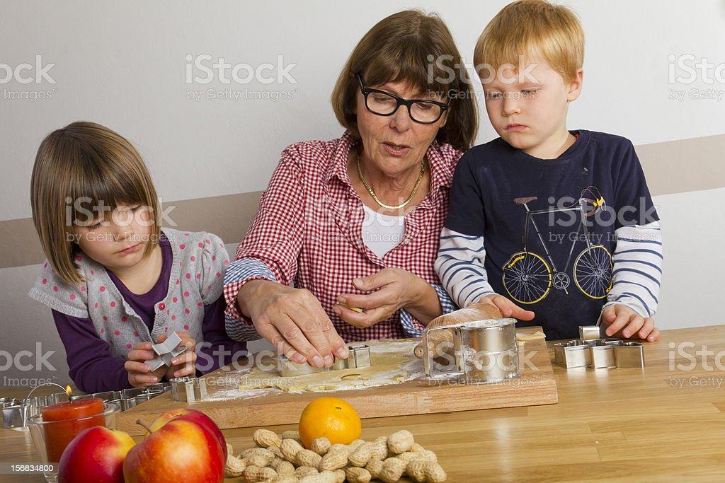 grandma and grandchildren baking royalty-free stock photo
