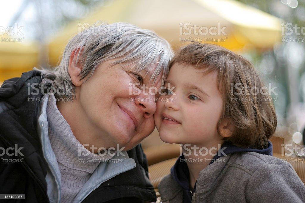 Grandma and granddaughter cuddling royalty-free stock photo