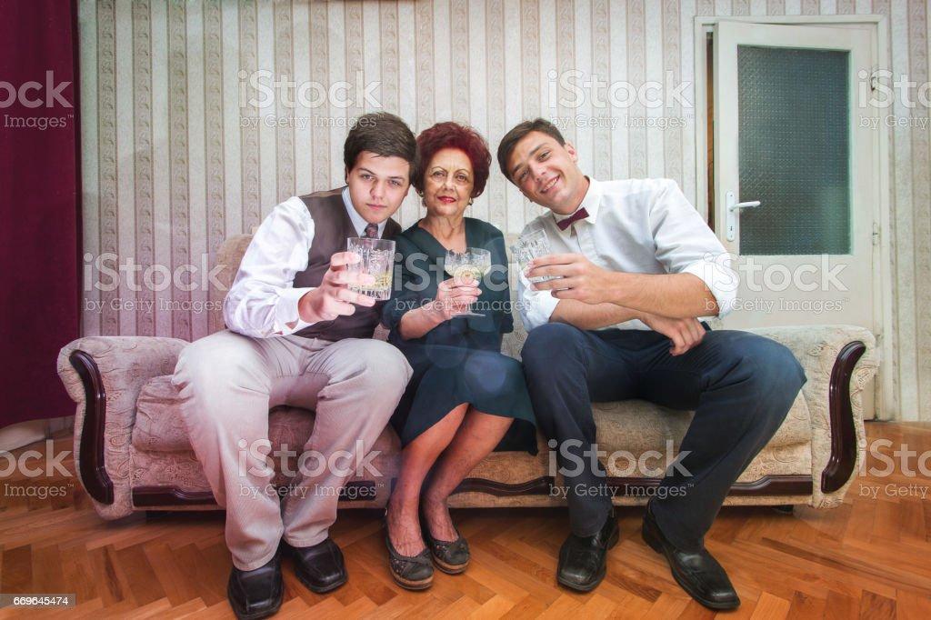 Grandma and her two grandchildren toast stock photo