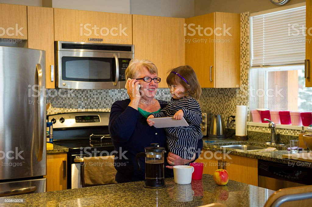 Grandma and toddler using a tablet stock photo
