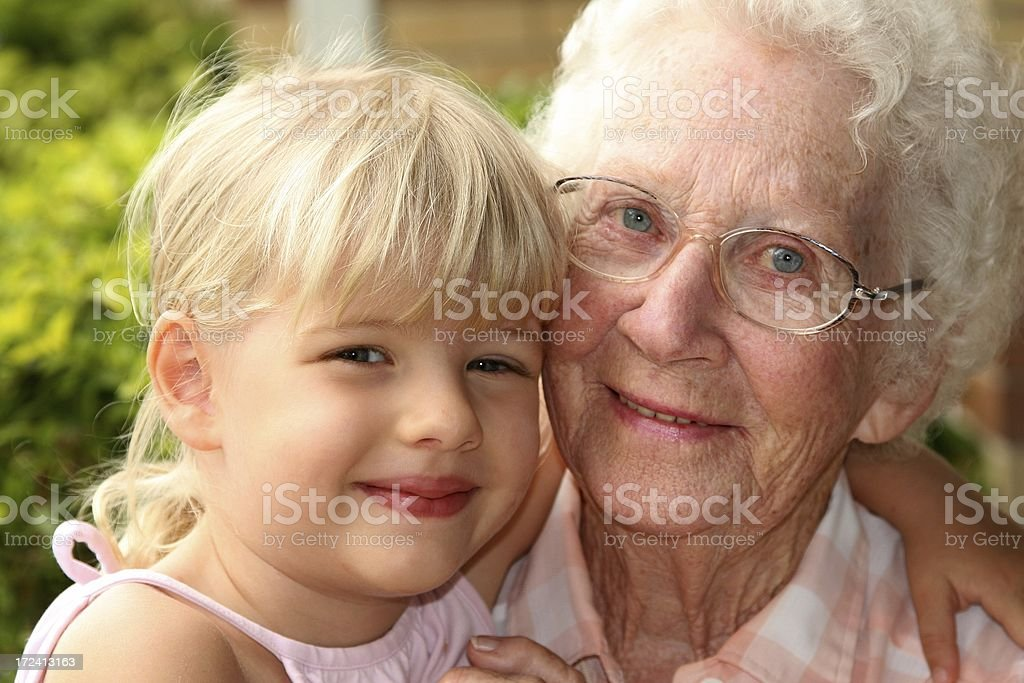 Grandma and young granddaughter stock photo