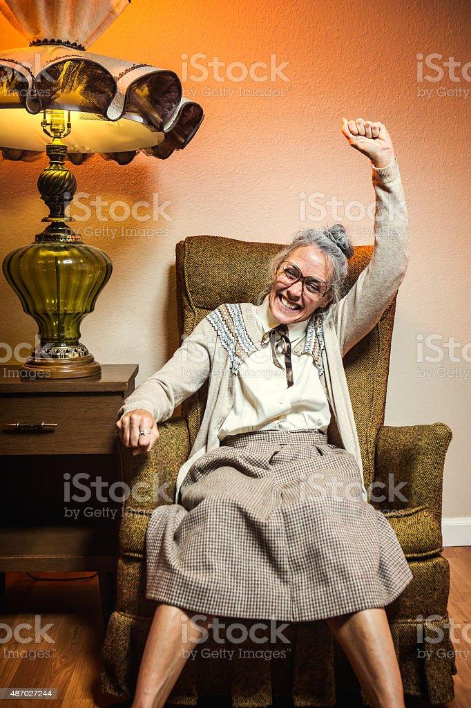 Grandma Celebrates Victory stock photo