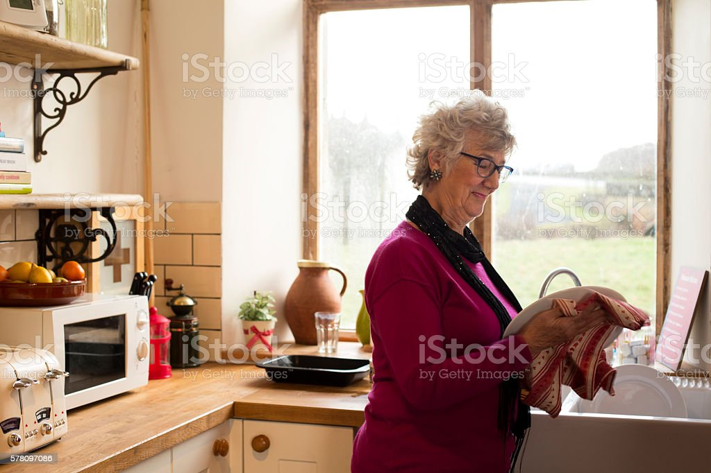 Grandma Drying Dishes stock photo