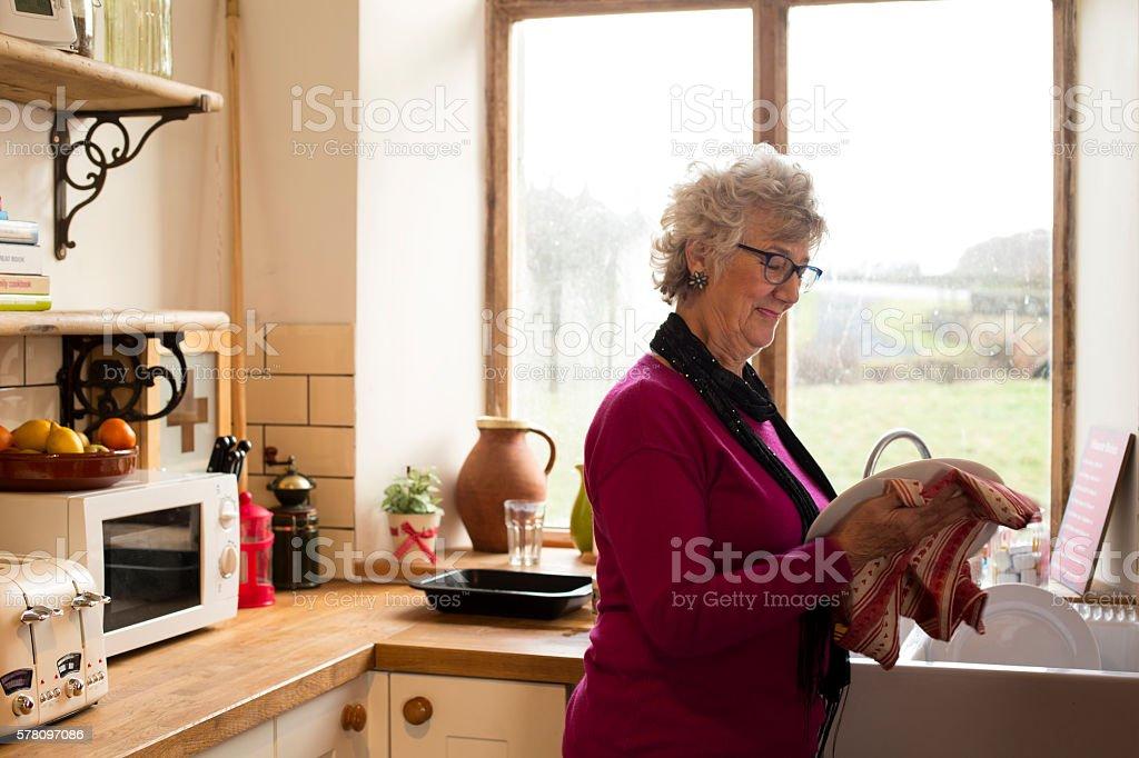 Grandma Drying Dishes stock photo