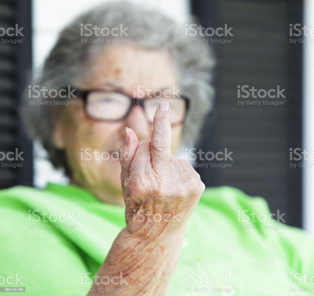 Grandma Flipping the Bird Closeup royalty-free stock photo