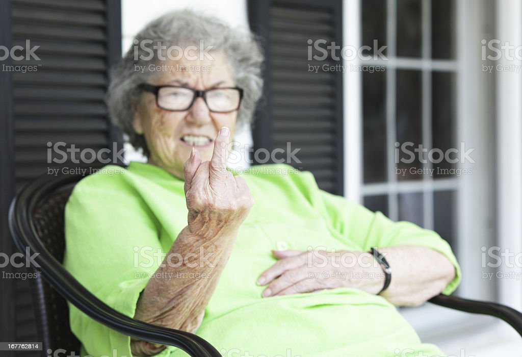 Grandma Flipping the Bird From Her Front Porch stock photo