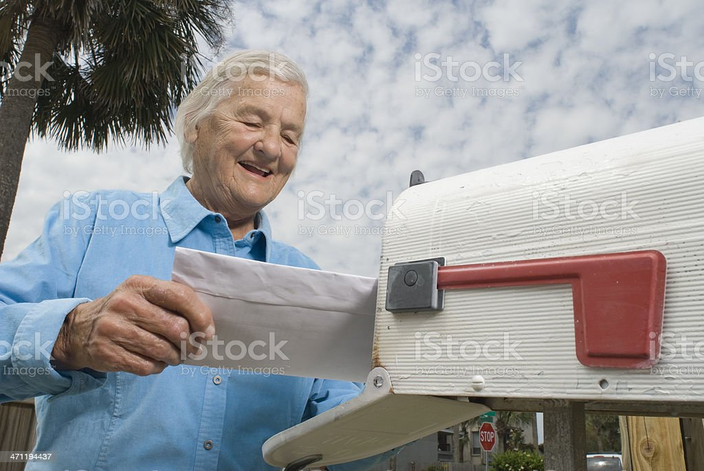 Grandma gets a letter royalty-free stock photo