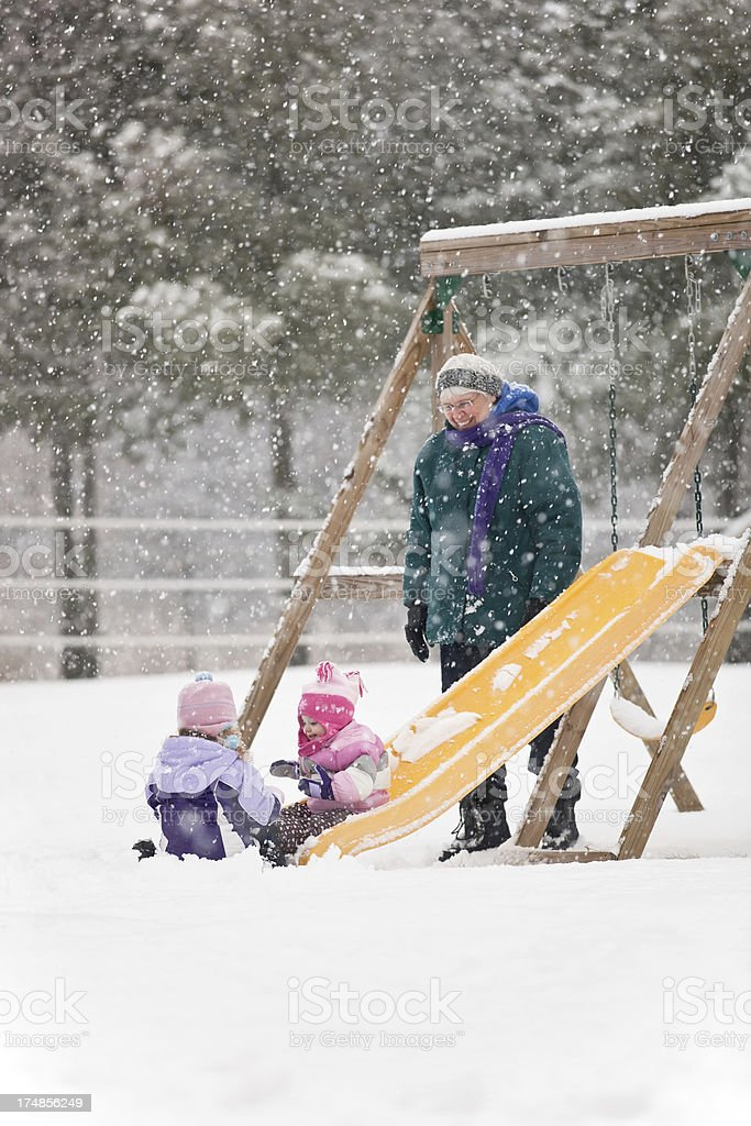 Grandma & Granddaughters Playing in Snow royalty-free stock photo